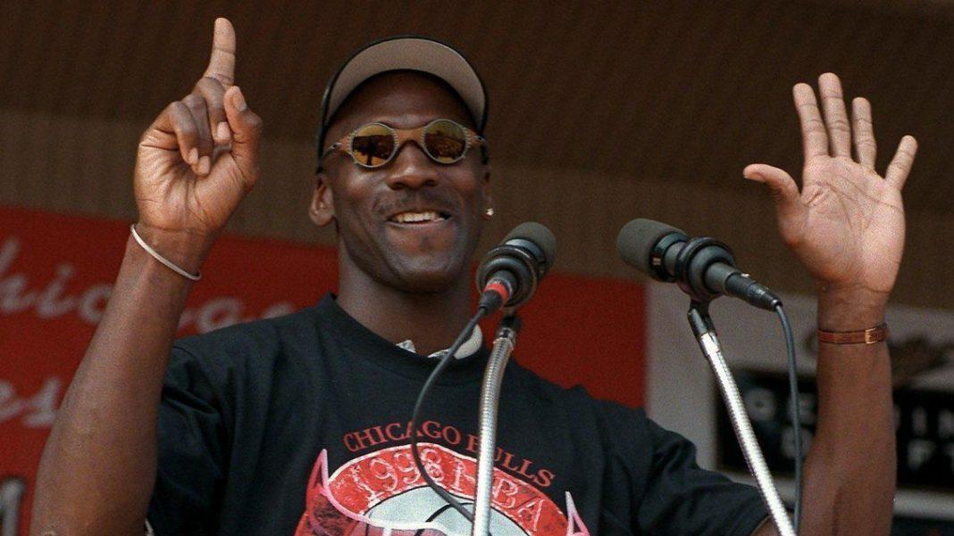 Michael Jordan points his 6 nba championships
