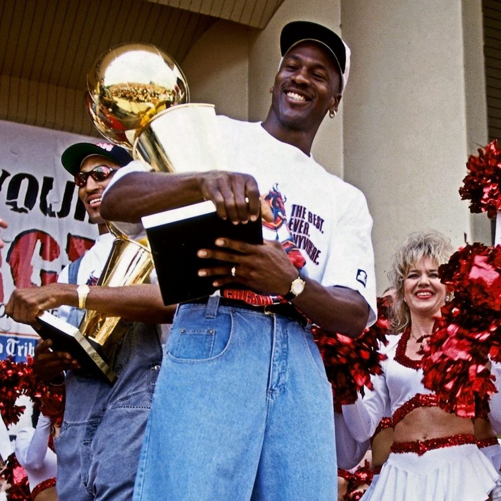 Michael Jordan holds the NBA championship trophy in 1996 parade.