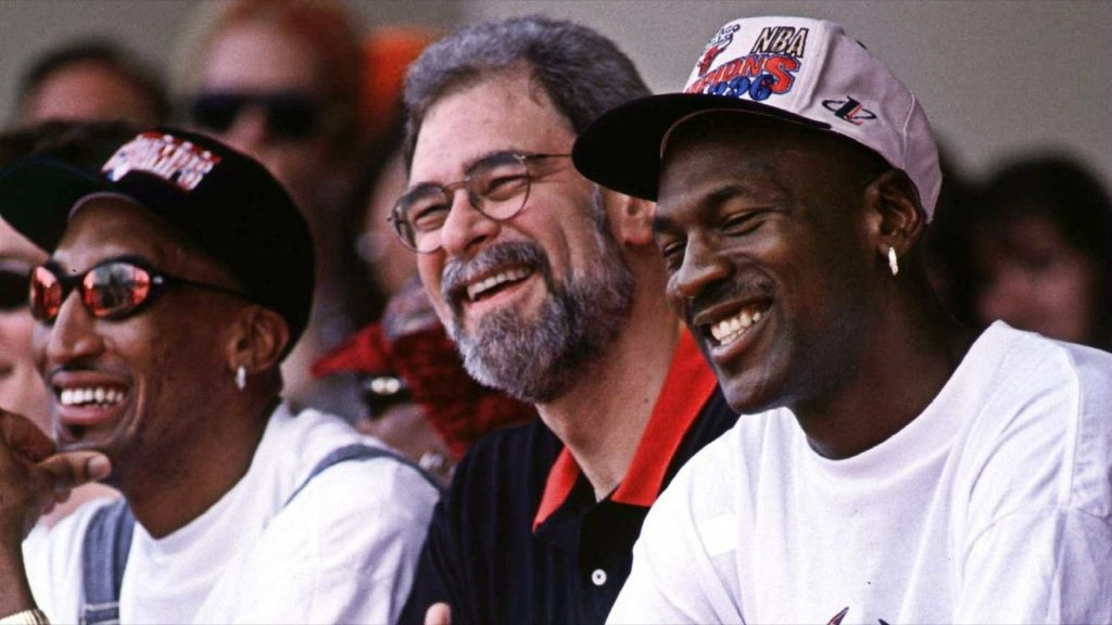 scottie pippen, phil jackson and michael jordan in 1996 championship parade